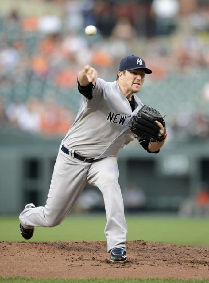 New York Yankees starter Phil Hughes delivers a pitch against the Baltimore Orioles during the first inning of a baseball game, Tuesday, May 21, 2013, in Baltimore. (AP Photo/Nick Wass)