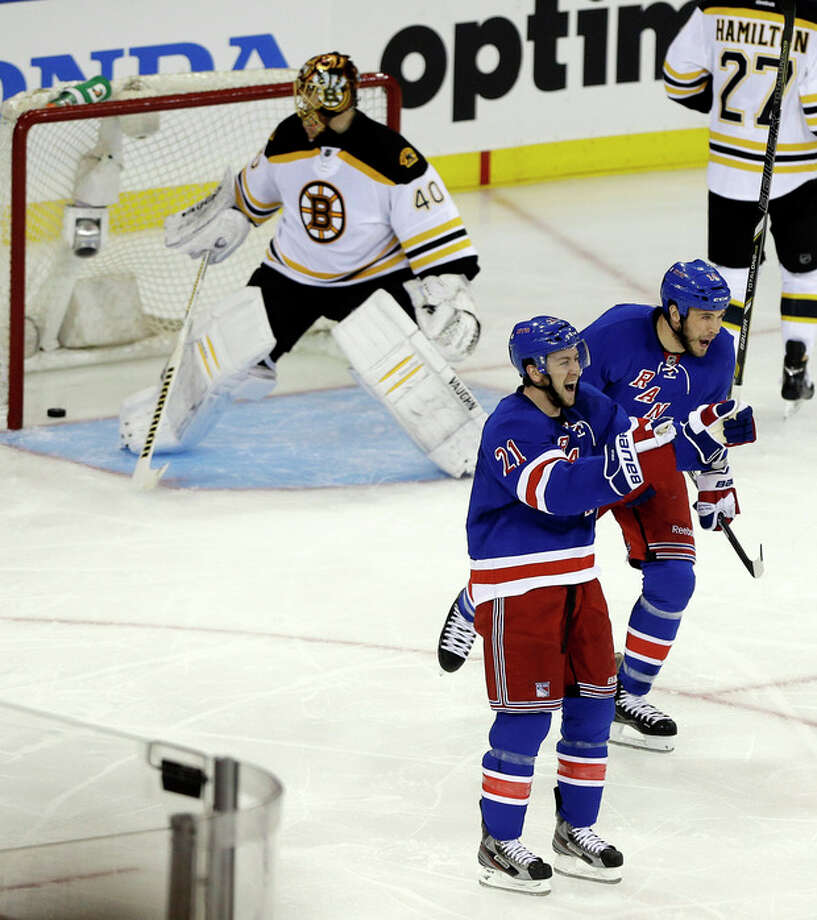 New York Rangers' Taylor Pyatt, right, and teammate Derek Stepan (21) celebrate after Pyatt scored a goal against Boston Bruins goalie Tuukka Rask (40), of Finland, during the second period in Game 3 of the Eastern Conference semifinals in the NHL hockey Stanley Cup playoffs Tuesday, May 21, 2013, in New York. (AP Photo/Frank Franklin II) / AP