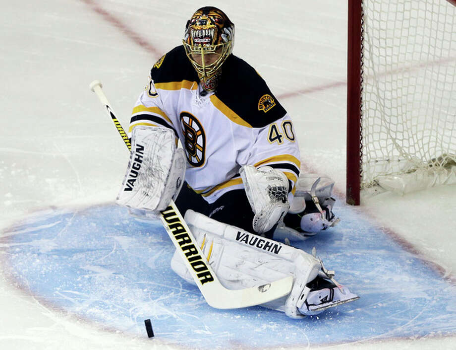 Boston Bruins goalie Tuukka Rask (40), of Finland, stops a shot on the goal against the New York Rangers during the first period in Game 3 of the Eastern Conference semifinals in the NHL hockey Stanley Cup playoffs Tuesday, May 21, 2013, in New York. (AP Photo/Frank Franklin II) / AP