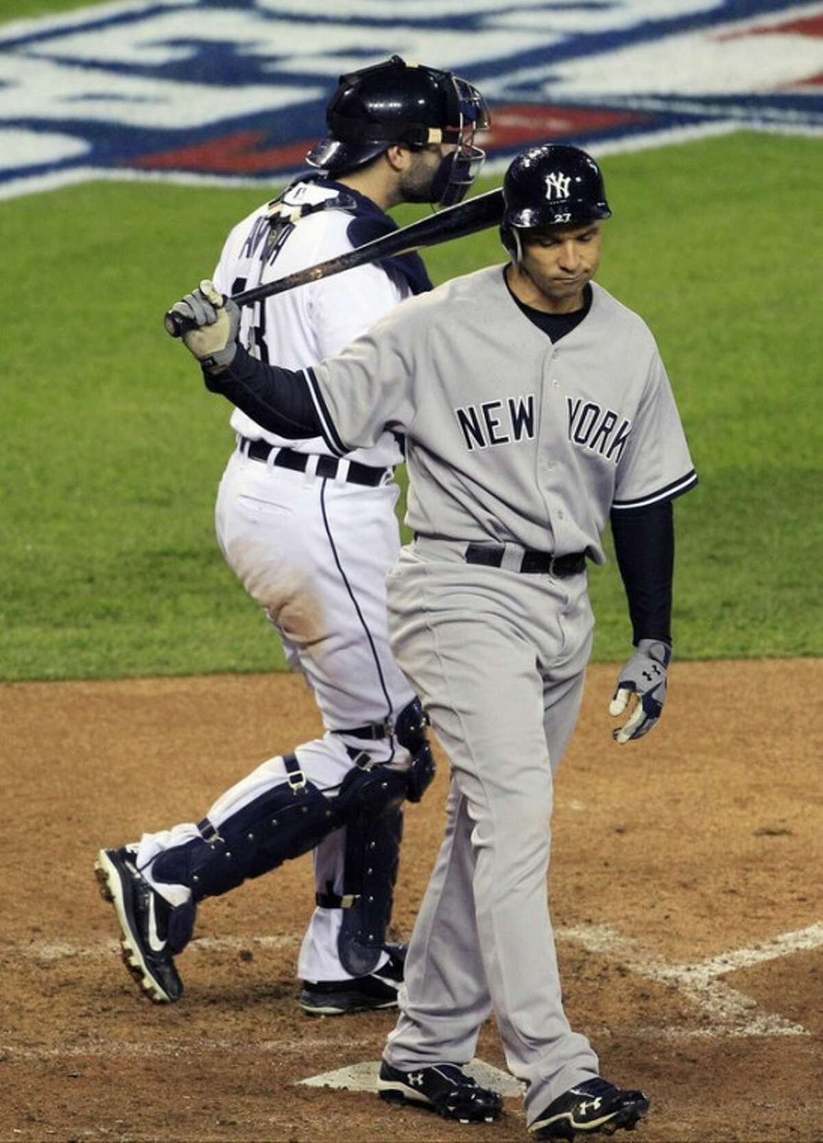 New York Yankees' Raul Ibanez reacts after striking out ending the game as Detroit Tigers' Alex Avila leaves home plate at Game 3 of the American League championship series Tuesday, Oct. 16, 2012, in Detroit. (AP Photo/Carlos Osorio)