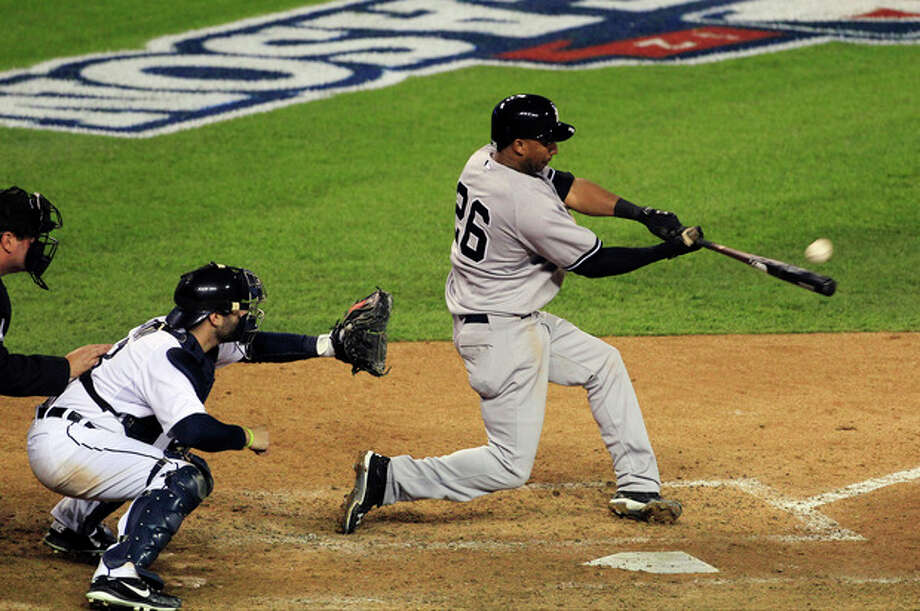New York Yankees' Eduardo Nunez hits a home run in the ninth inning during Game 3 of the American League championship series against the Detroit Tigers Tuesday, Oct. 16, 2012, in Detroit. (AP Photo/Carlos Osorio) / AP