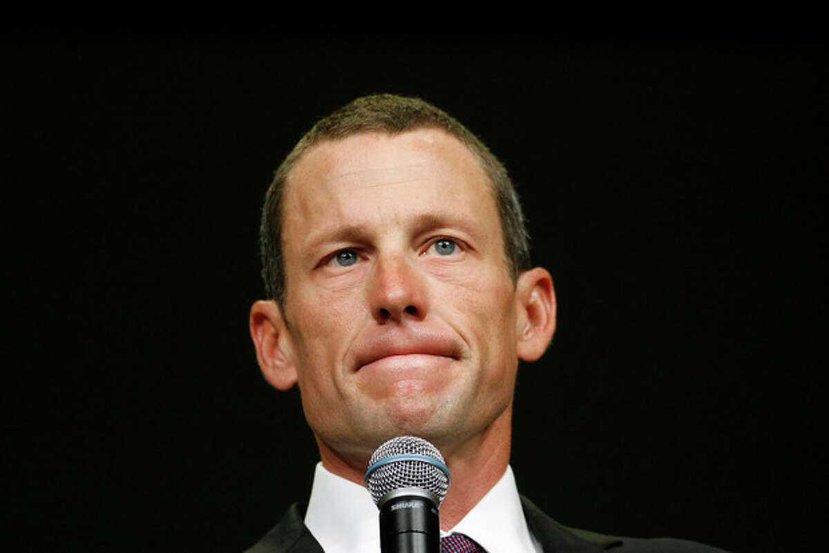 FILE - This Aug. 24, 2009 file photo shows Lance Armstrong during the opening session of the Livestrong Global Cancer Summit in Dublin, Ireland. Armstrong said Wednesday, Oct. 17, 2012, he is stepping down as chairman of his Livestrong cancer-fighting charity so the group can focus on its mission instead of its founder's problems. The move came a week after the U.S. Anti-Doping Agency released a massive report detailing allegations of widespread doping by Armstrong and his teams when he won the Tour de France seven consecutive times from 1999 to 2005. (AP Photo/Peter Morrison, File)