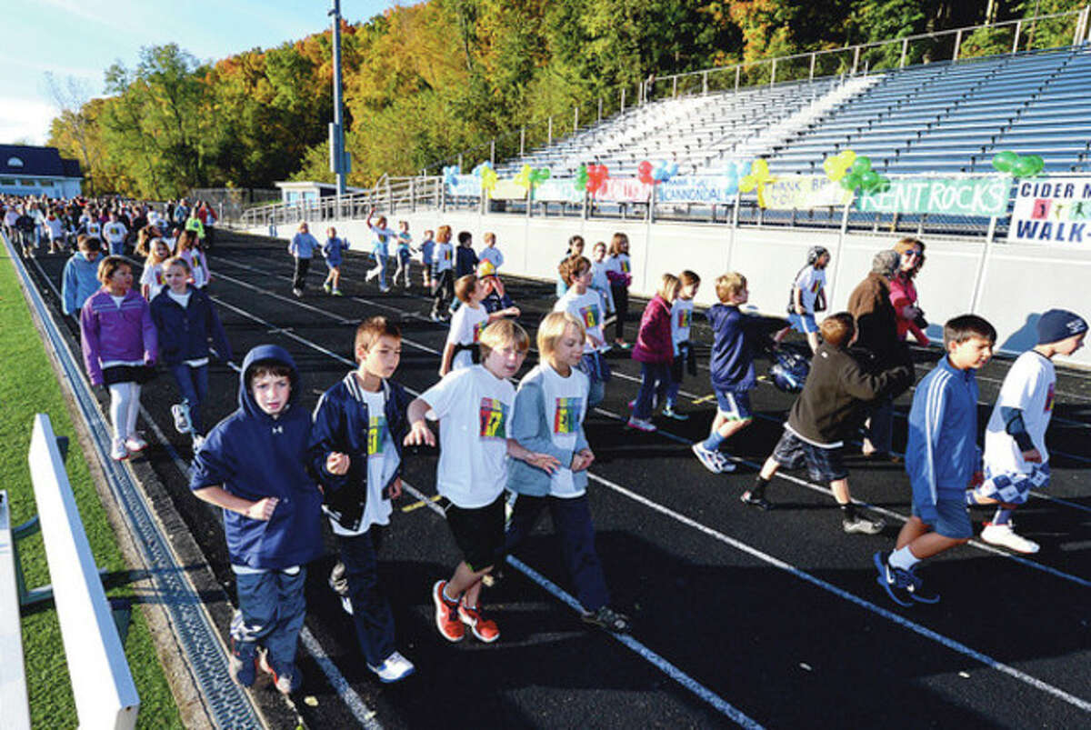 Cider Mill Elementary School students participate in the school's3rd annual Walkathon, the school's major fundraiser of the year, at the Fujitani stadium Wednesday morning. Cider Mill staff and students walked one mile at the track to raise money to fund school programs such as the author visits, field trips, fun nights, field days and other beneficial programs. Hour photo / Erik Trautmann