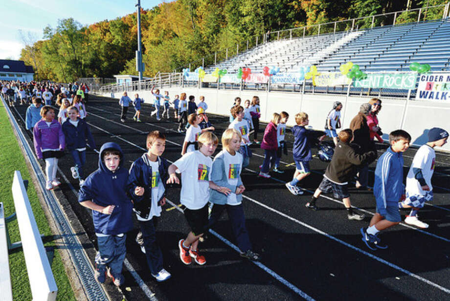 Cider Mill Elementary School students participate in the school's3rd annual Walkathon, the school's major fundraiser of the year, at the Fujitani stadium Wednesday morning. Cider Mill staff and students walked one mile at the track to raise money to fund school programs such as the author visits, field trips, fun nights, field days and other beneficial programs.Hour photo / Erik Trautmann / (C)2012, The Hour Newspapers, all rights reserved