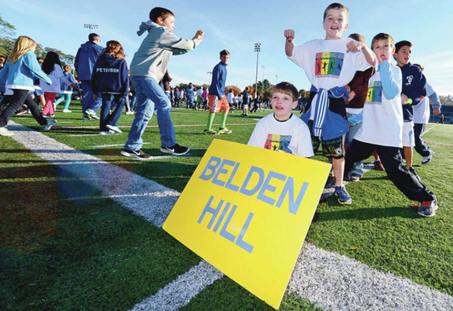Cider Mill Elementary School students wind down from the school's 3rd annual Walkathon, the school's major fundraiser of the year, at the Fujitani stadium Wednesday morning. Cider Mill staff and students walked one mile at the track to raise money to fund school programs such as the author visits, field trips, fun nights, field days and other beneficial programs.Hour photo / Erik Trautmann / (C)2012, The Hour Newspapers, all rights reserved