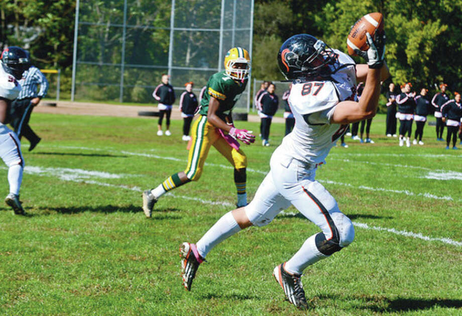 Photo by Erik TrautmannStamford's Jack Rakoczy, right, hauls in a pass for Stamford High School during Saturday's game against Trinity Catholic. / (C)2012, The Hour Newspapers, all rights reserved