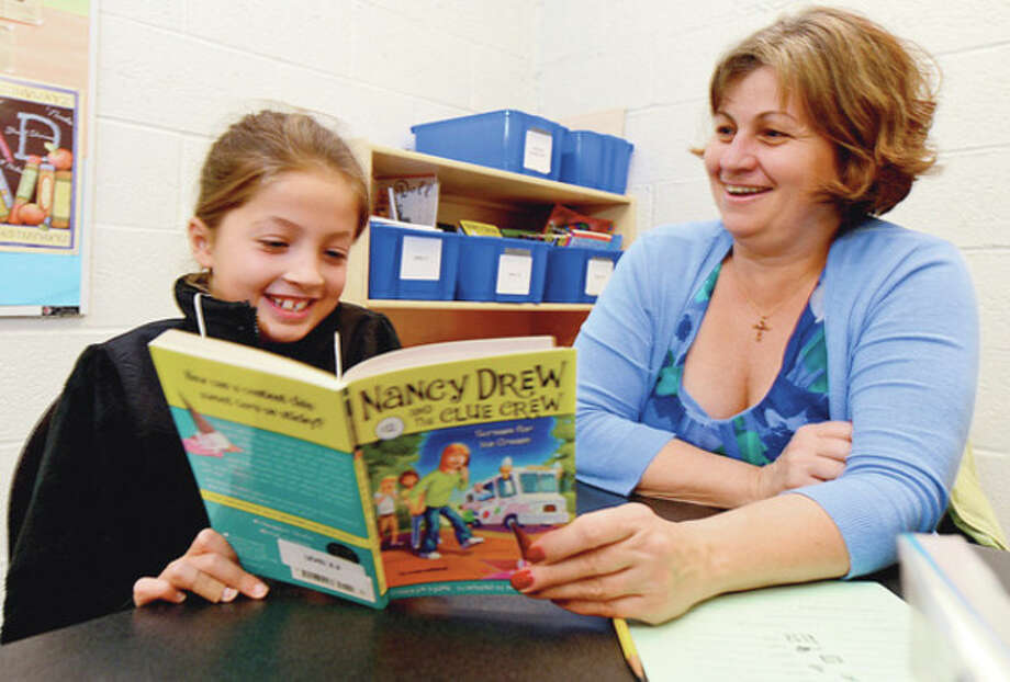 as part of the Stamford Public Schools Power Lunch Program which looks to increase children's' success in school and life through one-to-one reading experiences with caring adults at lunchtime. / (C)2012, The Hour Newspapers, all rights reserved