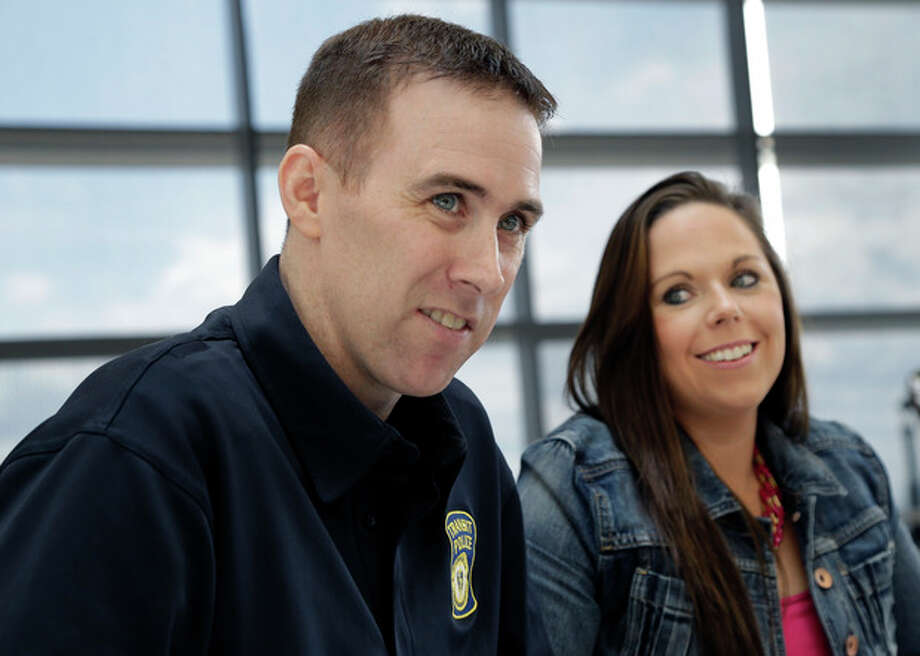 MBTA Police Officer Richard Donahue smiles with his wife, Kim, during an interview at Spaulding Rehabilitation Hospital in Boston's Charlestown section, Sunday, May 19, 2013. Donahue almost lost his life after being shot during the crossfire with the Boston Marathon bombing suspects in Watertown, Mass. (AP Photo/Elise Amendola) / AP