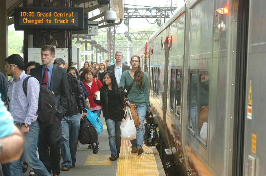 Hour Photo/Alex von Kleydorff Passengers arrive in Westport on an Eastbound Train From New York, the train then picked up passengers headed to New York.