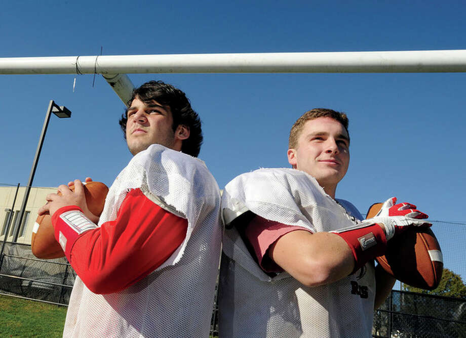 Hour photo/Matthew VinciNew Canaan's righty-lefty quarterback combo of Nick Cascione, left, and Ted Bossidy have given their opponents a lot to think about when either one goes under center. / (C)2011 {your name}, all rights reserved