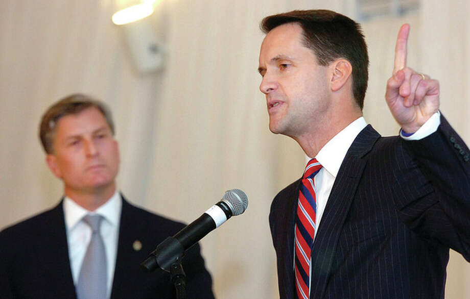 Alex von KleydorffCongressman Jim Himes, right, makes a point while his challenger Steve Obsitnik listens during a debate at The Greenwich Hyatt Wednesday night. The two are competing for the 4th Congressional District seat. / 2012 The Hour Newspapers