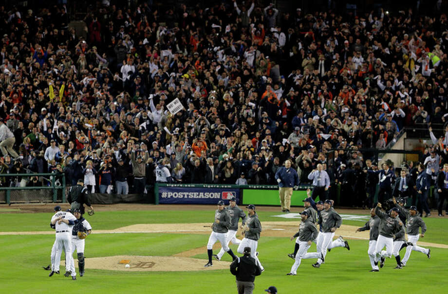 The Detroit Tigers celebrate after winning Game 4 of the American League championship series 8-1, against the New York Yankees, Thursday, Oct. 18, 2012, in Detroit. The Tigers move on to the World Series. (AP Photo/Charlie Riedel) / AP