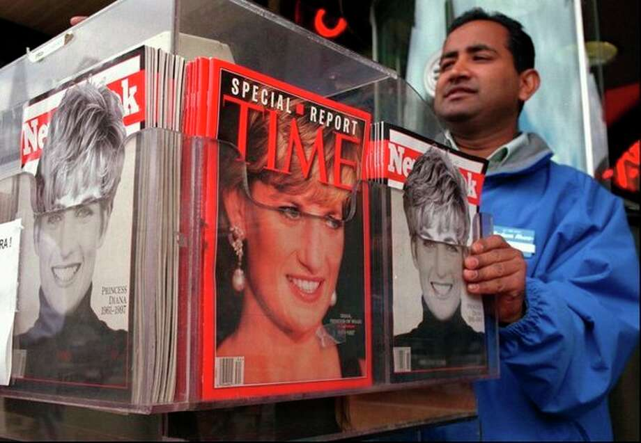 FILE - In this Thursday, Sept. 4, 1997, file photo, Cashier Mizan Rahman makes change for a customer from behind a display of the latest news weeklies at the Out of Town News stand in Harvard Square in Cambridge, Mass. Newsweek announced Thursday, Oct. 18, 2012 that it will end its print publication after 80 years and shift to an all-digital format in early 2013. Its last U.S. print edition will be its Dec. 31 issue. The paper version of Newsweek is the latest casualty of a changing world where readers get more of their information from websites, tablets and smartphones. It's also an environment in which advertisers are looking for less expensive alternatives online. (AP Photo/Julia Malakie, File) / AP