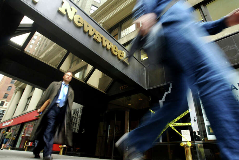 FILE- In this Monday, May 16, 2005, file photo, pedestrians walk past the Broadway entrance to the Newsweek. building in New York. Newsweek announced Thursday, Oct. 18, 2012 that it will end its print publication after 80 years and shift to an all-digital format in early 2013. Its last U.S. print edition will be its Dec. 31 issue. The paper version of Newsweek is the latest casualty of a changing world where readers get more of their information from websites, tablets and smartphones. It's also an environment in which advertisers are looking for less expensive alternatives online. (AP Photo/Mary Altaffer) / AP