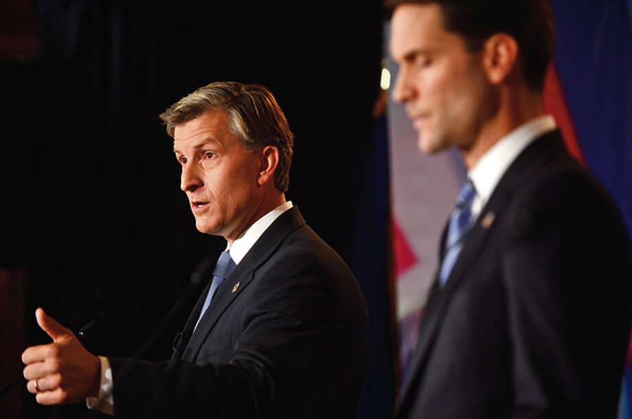 Republican challenger Steve Obsitnik and Congressman Jim Himes debate at the Norwalk Inn Thursday afternoon. Hour photo / Erik Trautmann / (C)2012, The Hour Newspapers, all rights reserved