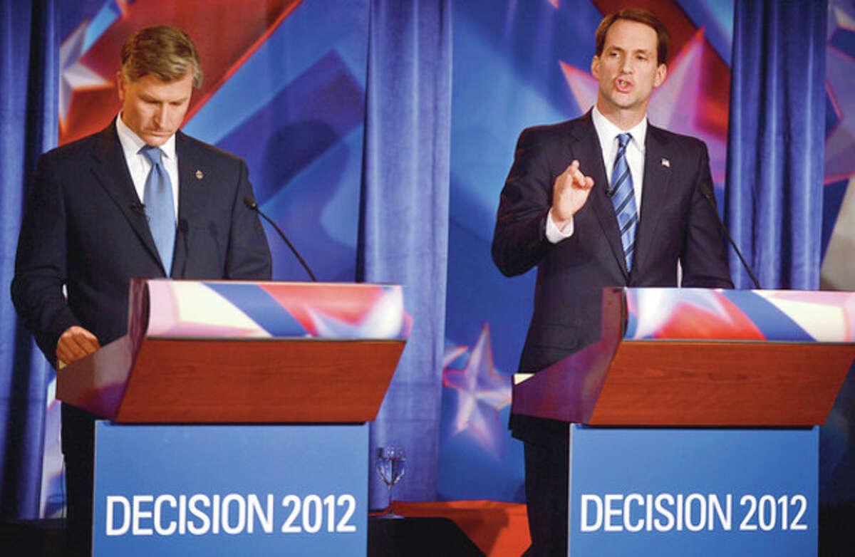 Congressman Jim Himes and republican challenger Steve Obstinik debate at the Norwalk Inn Thursday afternoon. Hour photo / Erik Trautmann