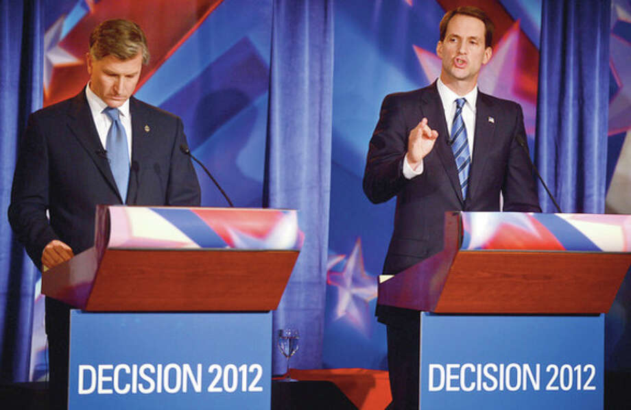 Congressman Jim Himes and republican challenger Steve Obstinik debate at the Norwalk Inn Thursday afternoon.Hour photo / Erik Trautmann / (C)2012, The Hour Newspapers, all rights reserved