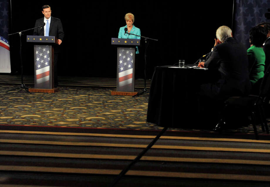 Democratic candidate, U.S. Rep. Chris Murphy, D-Conn., left, and Republican candidate for U.S. Senate Linda McMahon, right, debate in Hartford, Conn., Thursday, Oct. 18, 2012. The two are vying for the Senate seat now held by Joe Lieberman, an independent who's retiring. (AP Photo/Jessica Hill) / FR125654 AP