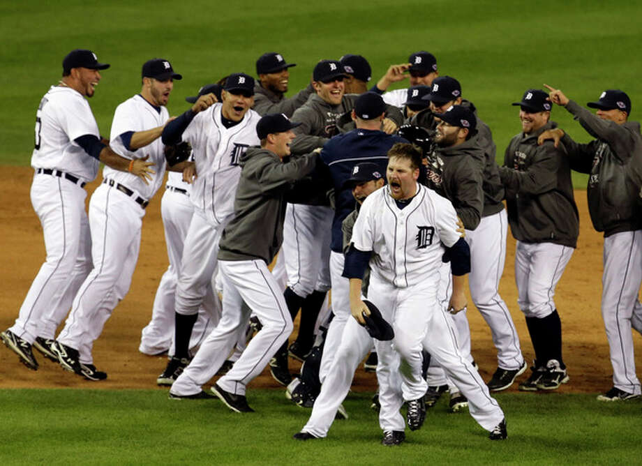 Detroit Tigers' Phil Coke and teammates celebrate after winning Game 4 of the American League championship series against the New York Yankees Thursday, Oct. 18, 2012, in Detroit. The move on to the World Series. (AP Photo/Darron Cummings) / AP
