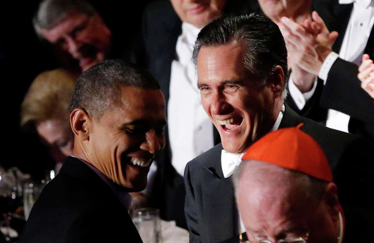 Republican presidential candidate and former Massachusetts Gov. Mitt Romney and President Barack Obama laugh as Romney gets up to address the 67th annual Alfred E. Smith Memorial Foundation Dinner, a charity gala organized by the Archdiocese of New York, Thursday, Oct. 18, 2012, at the Waldorf Astoria hotel in New York. (AP Photo/Charles Dharapak)