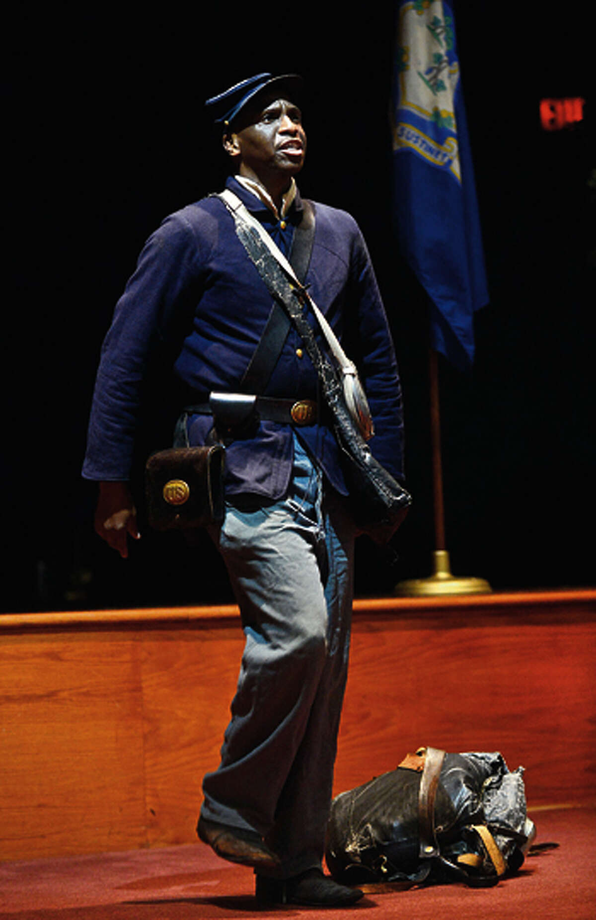 Kevin Johnson, a Civil War reenactor, tells the story of William Webb, an African-American Civil War soldier, to the Lifetime Learners Institute at Norwalk Community College Friday afternoon. His presentation looked at the struggles that Webb had to endure as a black infantryman in the Union Army. Hour photo / Erik Trautmann