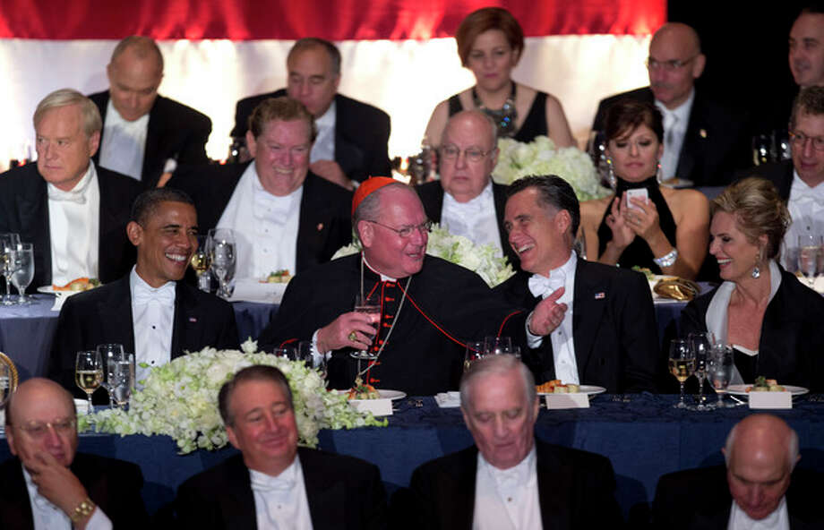 From left, President Barack Obama, Cardinal Timothy Dolan, Republican presidential candidate, former Massachusetts Gov. Mitt Romney, and his wife Ann Romney attend the Archdiocese of New York's 67th Annual Alfred. E. Smith Memorial Foundation Dinner, Thursday, Oct. 18, 2012, at the Waldorf Astoria Hotel in New York. (AP Photo/Carolyn Kaster) / AP