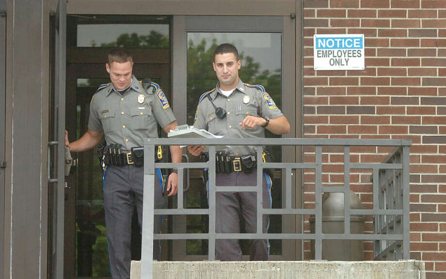Hour Photo/Alex von Kleydorff State Police exit the rear of the Norwalk Superior Court after a bomb threat evacuated the court Wednesday morning
