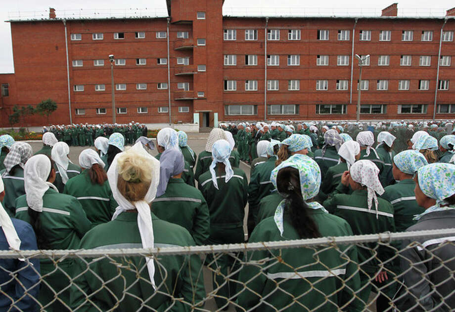 "In this photo taken Aug. 22, 2012 imprisoned women stand during a morning inspection at a women's prison in a town of Sarapul, central Russia. Two members of the punk band Pussy Riot will serve their sentence in a penal colony far from Moscow that is like what a former inmate describes as a ""nasty Girl Scout camp."" Although Russia's prison system is a far cry from Stalin's gulag, the principle remains the same: to isolate people from their families and wear them down through ""corrective labor,"" which for women usually means hunching over a sewing machine. Maria Alyokhina and Nadezhda Tolokonnikova will have to quickly learn the inner laws of prison life, survive the dire food and medical care, and risk reprisal from inmates either offended by their ""punk prayer"" against President Vladimir Putin or ordered to pressure them by higher authorities. (AP Photo/Yuri Tutov) / AP"