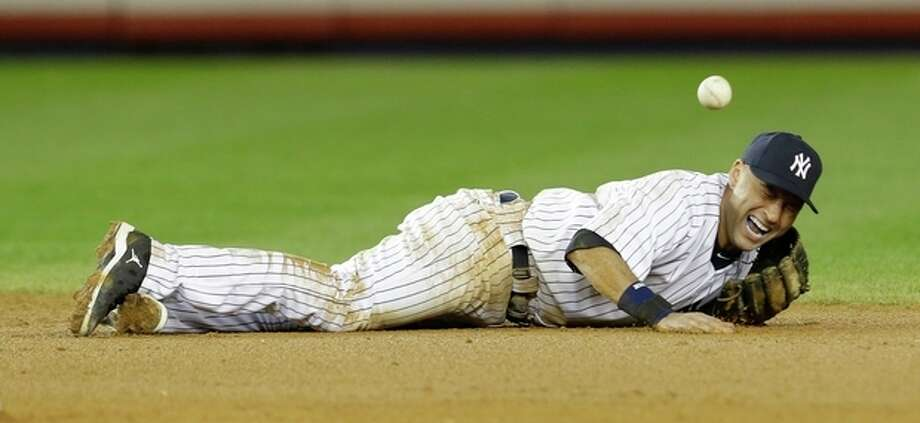 New York Yankees shortstop Derek Jeter reacts after injuring himself in the 12th inning of Game 1 of the American League championship series against the Detroit Tigers early Sunday, Oct. 14, 2012, in New York.(AP Photo/Paul Sancya ) / AP