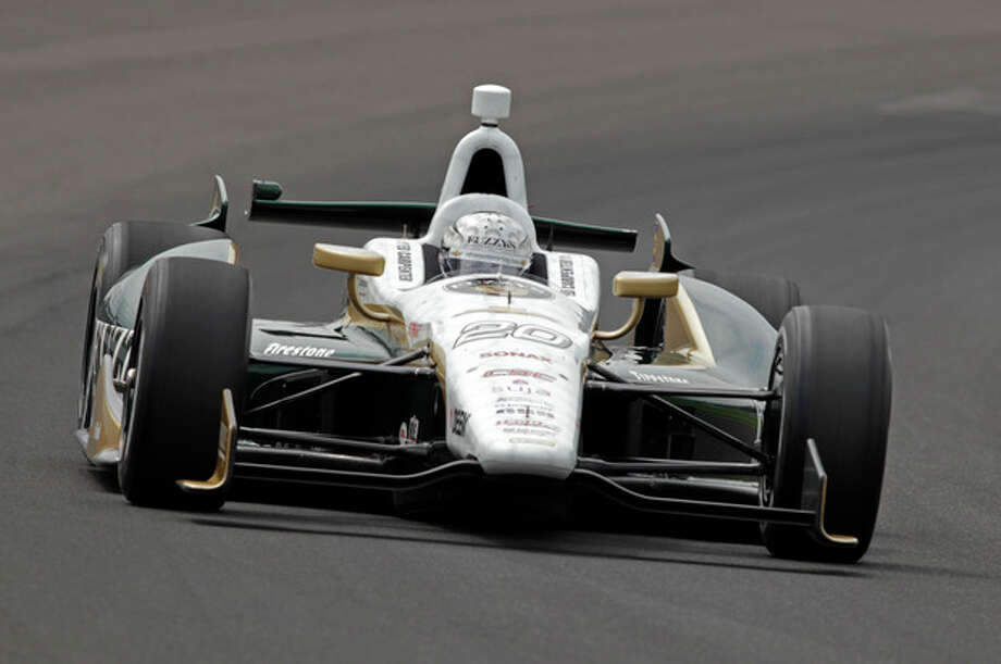 Ed Carpenter drives through the first turn on his qualification run on the first day of qualifications for the Indianapolis 500 auto race at Indianapolis Motor Speedway in Indianapolis, Saturday, May 18, 2013. (AP Photo/AJ Mast) / FR123854 AP