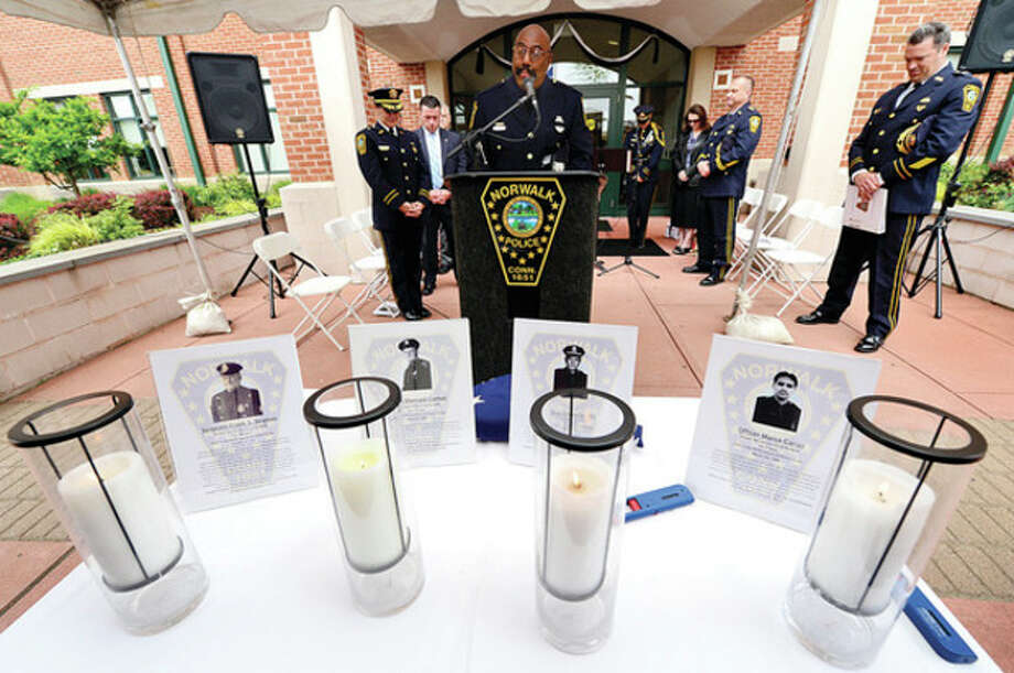 "Hour photo / Erik Trautmann:Honoring sacrificesmade for NorwalkAbove, the Rev. Carleton Giles, a retired Norwalk police officer, gives the closing prayer as he joins Norwalk police and residents as they commemorate the officers who died in the line of duty during the Norwalk Department of Police Services' annual ""Police Memorial Service"" Friday. Right, Norwalk police detective Kristina LaPak and David Harris sing ""The Prayer"" as police and residents commemorate the officers who died in the line of duty. / (C)2013, The Hour Newspapers, all rights reserved"