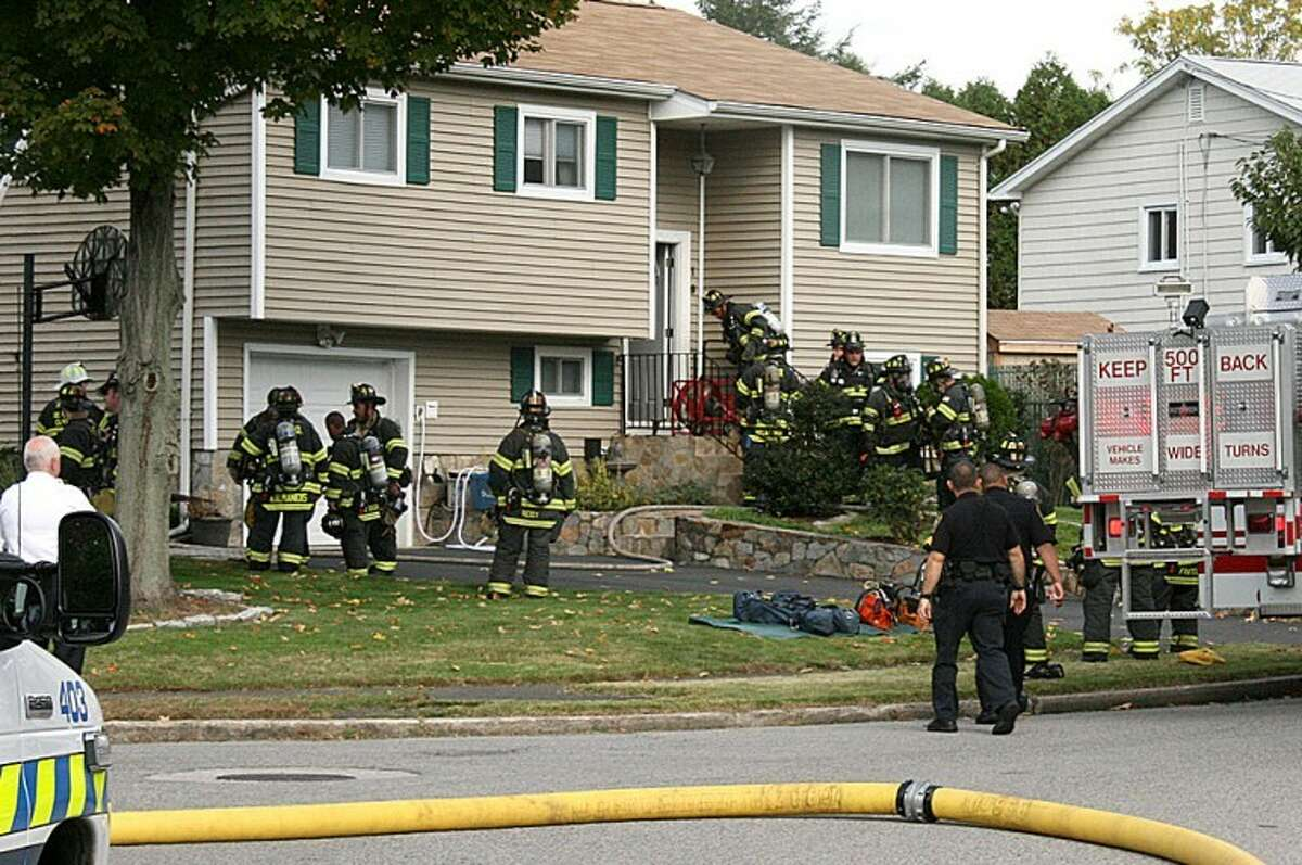 Photo by Chris Bosak Norwalk and Westport firefighters responded to a fire at 19 Country Club Road in Norwalk on Monday morning.
