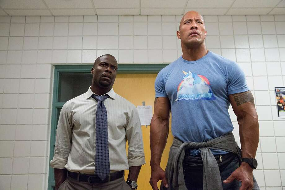 Kevin Hart (left) and Dwayne Johnson. Photo: Claire Folger, Associated Press