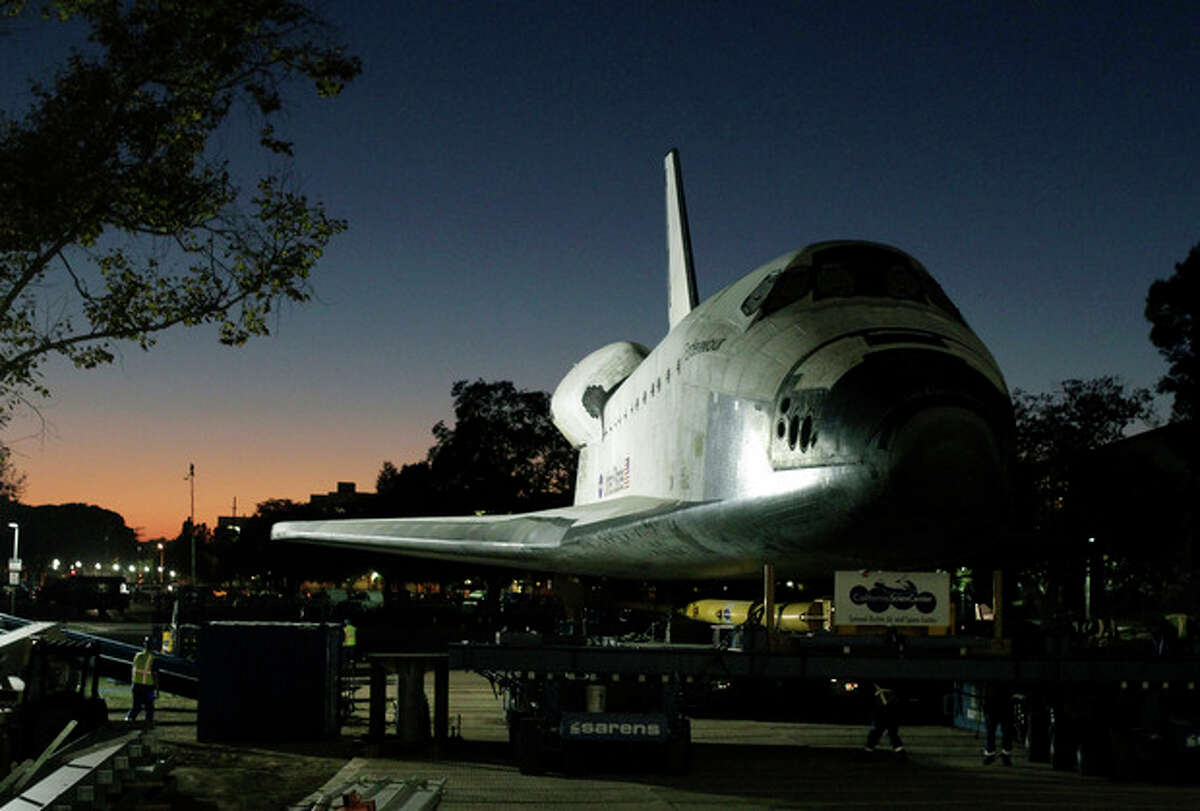 The space shuttle Endeavour is moved to the hangar in the California Science Center for its last stop on Sunday, Oct. 14, 2012, in Los Angeles. Endeavour arrived at the museum after a 12-mile parade with thousands of onlookers ending with a greeting party of city leaders and other dignitaries. (AP Photo/Los Angeles Times, Lawrence K. Ho, Pool)