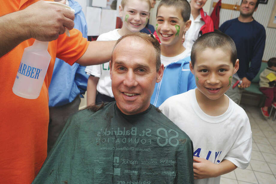 Hour photo / Matthew VinciSixth-grade lacrosse coach Tony Grandolfo and his team get their hair cut at the Locks for Lyla fundraiser at Arena Hairstyling in Wilton.