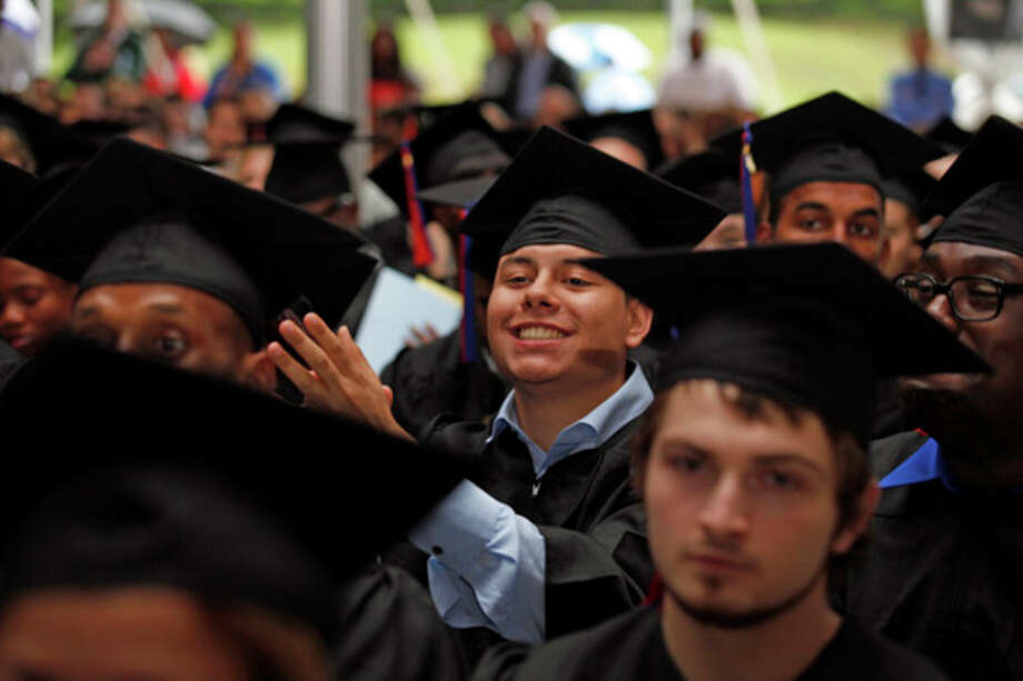 Hour photo / Danielle RobinsonOnix DeJesus applauds Ben Engel as he speaks during the 51st annual commencement ceremony at Norwalk Community College Thursday afternoon.
