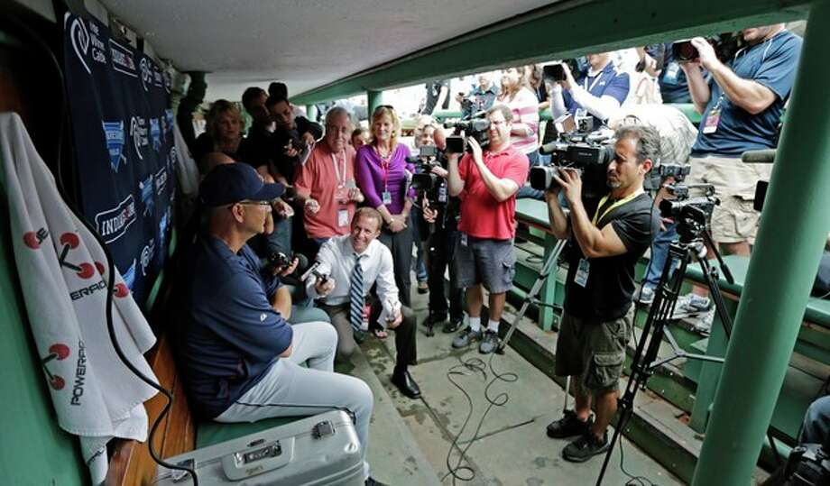 Cleveland Indians manager Terry Francona, left, is surrounded by members of the media in the visitor's dugout before a baseball game against the Boston Red Sox at Fenway Park in Boston, Thursday, May 23, 2013. Francona was Red Sox manager for the 2004 and 2007 World Series Championship seasons. (AP Photo/Charles Krupa) / AP