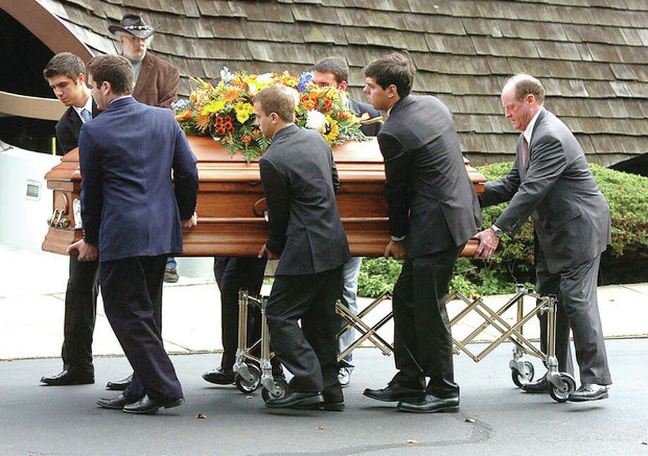 Hour photo / Alex von KleydorffPallbearers accompany Jonathan Brown at his funeral at United Church of Rowayton on Monday. / 2012 The Hour Newspapers