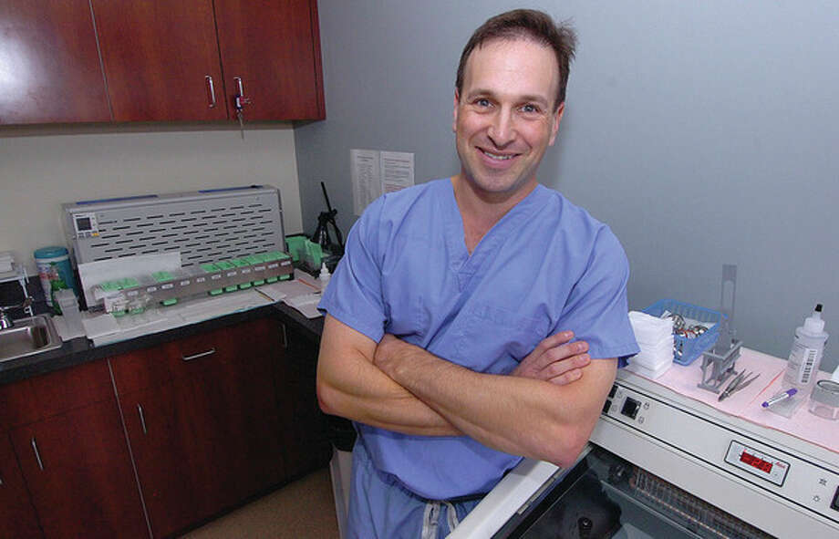 Hour photo / Alex von KleydorffAndrew M. Herbst, M.D., is a Mohs surgeon who specializes in dermatology at the Skin Cancer Center of Fairfield County office in Norwalk. / 2012 The Hour Newspapers