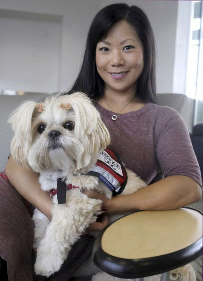 AP Photo/Journal Inquirer, Jim MichaudStaff Sgt. Sandra Lee poses for a photograph with her service dog Emma in Manchester.