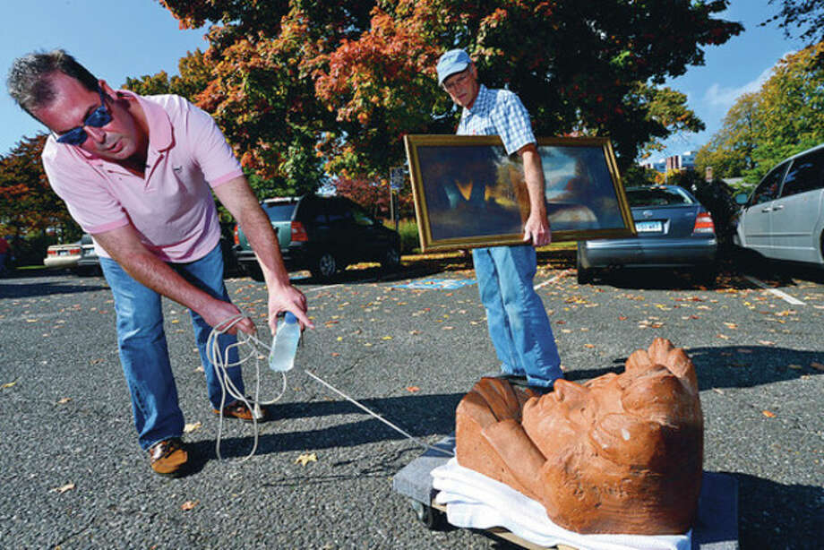 """Hour photo / Erik TrautmannGeorge Elam and his father, Gordon, bring items for appraisal to the Lockwood-Mathews Mansion Museum's annual """"Antiques Appraisal Weekend and Vintage & Designer Jewelry Sale"""" Saturday. / (C)2012, The Hour Newspapers, all rights reserved"""