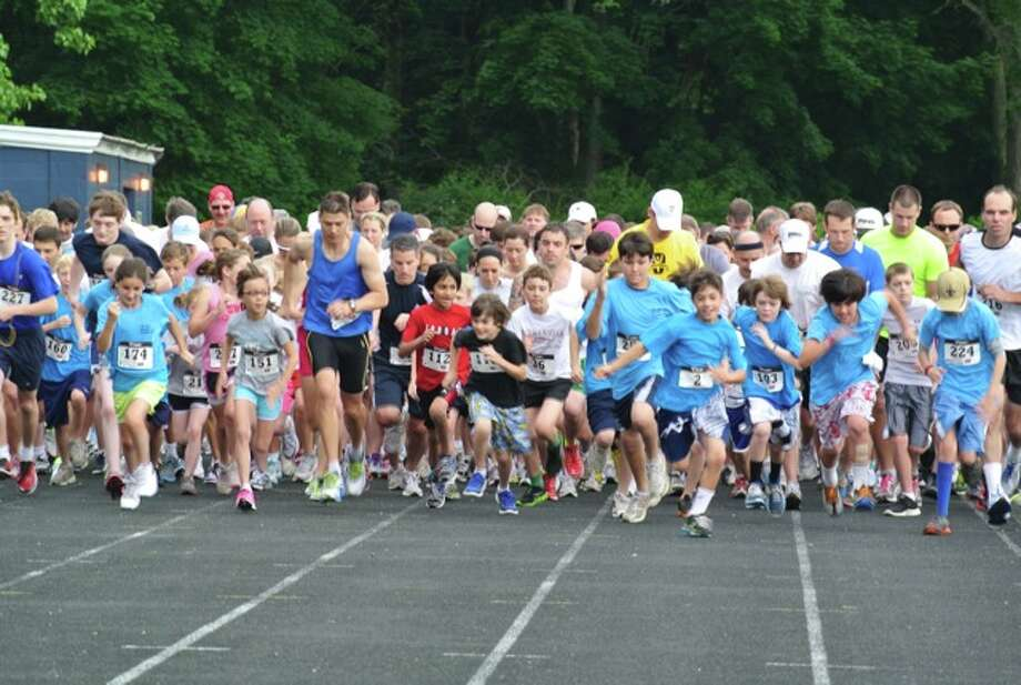 Participants take part in last year's Get Smart for Wilton 5K road race to raise funds for the Wilton Education Foundation in this contributed photo. This year's race, organized by the local running group, Sol Sisters, will take place on Memorial Day weekend, with 95 percent of the funds supporting technology offerings, professional development and arts and music programs at Wilton Public Schools.