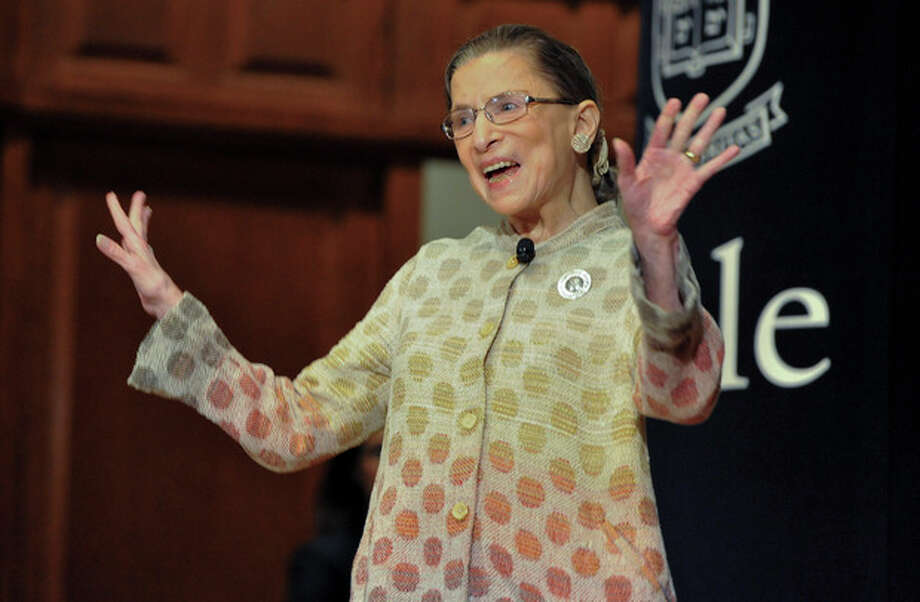 Supreme Court Justice Ruth Bader Ginsburg waves to the audience during a speaking engagement at Yale University in New Haven, Conn., Friday, Oct. 19, 2012. The 79-year-old Ginsburg's visit is a part of Yale's Gruber Program for Global Justice and Women's Rights. (AP Photo/Jessica Hill) / FR125654 AP