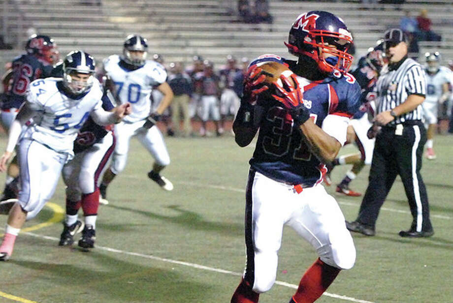 Hour photo/Alex von KleydorffBrien McMahon's Kyle Jordan grabs a pass during Friday night's game against Fairfield Ludlowe at Casagrande Field. Jordan turned the reception into a touchdown. McMahon won, 27-7. / 2012 The Hour Newspapers