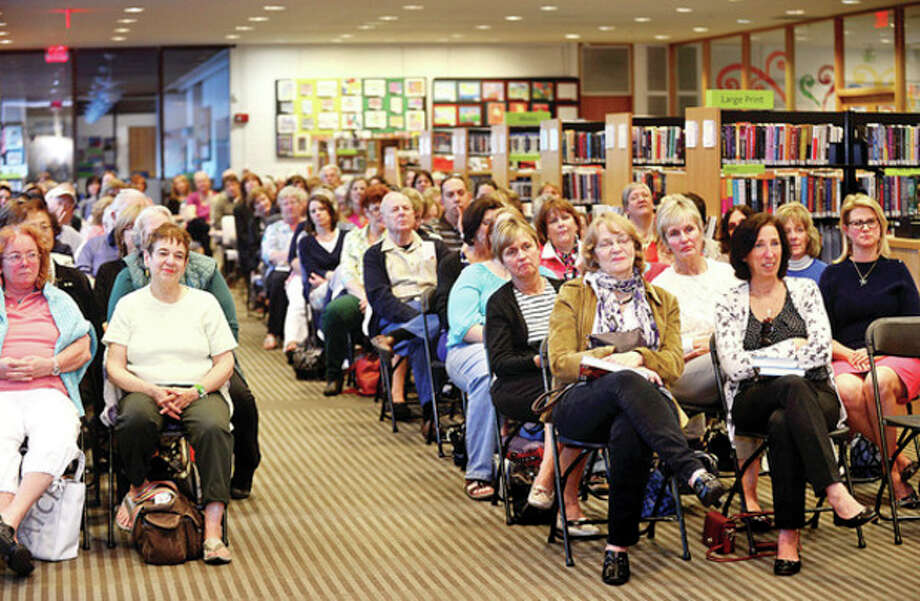 Nearly 300 hundred poeple filled the audience for world reknowned author Mary Higgins Clark as she visits the Wilton Public Library Friday night for a brief biography, reading and book signing.Hour photo / Erik Trautmann / (C)2013, The Hour Newspapers, all rights reserved