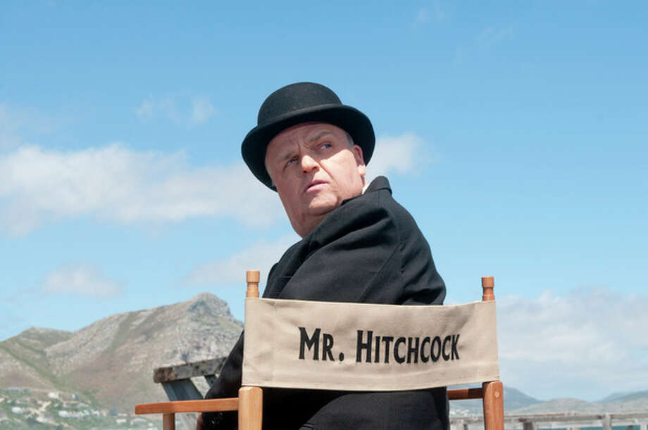 """This image released by HBO shows Toby Jones, portraying Alfred Hitchcock in a scene from the film """"The Girl,"""" premiering Saturday, Oct. 20, 2012 at 9 p.m. EST. The HBO movie dramatizes the making of Hitchcock's """"The Birds"""" and his relationship with actress Tippi Hedren. (AP Photo/HBO, Kelly Walsh) / HBO"""