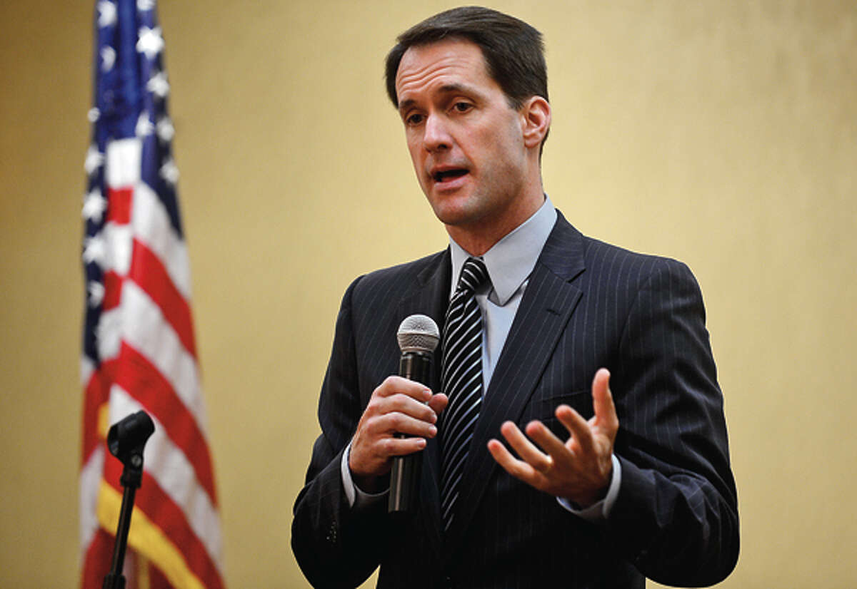 Congressman Jim Himes (D-4) answers questions during a forum sponsored by the Stamford Chamber of Commerce at the Stamford Forum Wednesday. Hour photo / Erik Trautmann