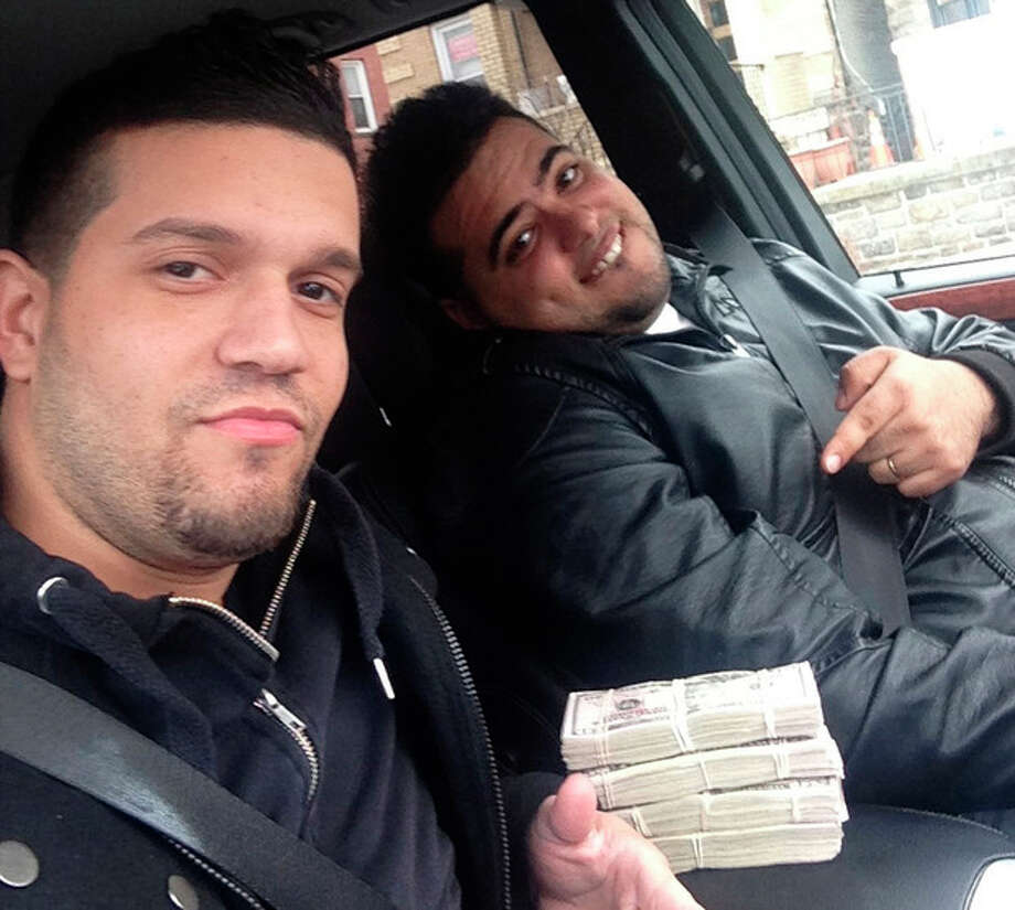 In this undated photo provided by the United States Attorney's Office for the Southern District of New York, Elvis Rafael Rodriguez, left, and Emir Yasser Yeje, pose with bundles of cash allegedly stolen using bogus magnetic swipe cards at cash machines throughout New York. Prosecutors in New York on Thursday, May 9, 2103 said that they are members of worldwide gang of criminals who stole $45 million in hours by hacking into a database of prepaid debit cards and draining cash machines around the globe. An indictment unsealed Thursday accused U.S. cell ringleader Alberto Yusi Lajud-Pena and seven other New York suspects of withdrawing $2.8 million in cash from hacked accounts in less than a day. (AP Photos/U.S. Attorney's Office for the Southern District of New York) / US Attorneys Office