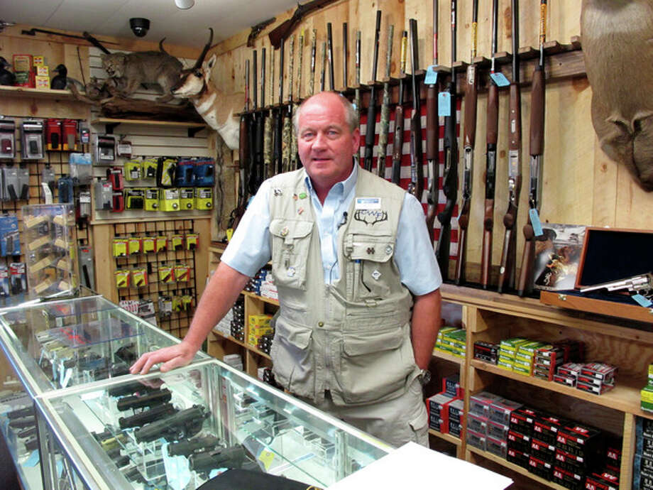 This photo taken Aug. 22, 2012, shows Central Wisconsin Firearms owner Frederick Prehn in his store in Wausau, Wis. He says he's had to expand his business to the new location last summer because of increased gun sales. He attributes the spike to Wisconsin's new concealed carry law as well as the uncertainty about the upcoming election. President Barack Obama is presiding over a heyday for the gun industry despite predictions he would be the most anti-gun president in history. An Associated Press analysis finds gun sales are on the rise and stocks of major gun companies are up. The number of federally licensed gun dealers is increasing for the first time in nearly 20 years. And the National Rifle Association is bursting with cash and political clout. (AP Photo/Carrie Antlfinger) / AP