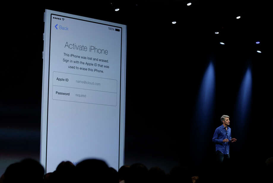 Craig Federighi, senior vice president of Software Engineering at Apple demonstrates the new activation lock security feature in iOS 7 during the keynote address of the Apple Worldwide Developers Conference Monday, June 10, 2013 in San Francisco. (AP Photo/Eric Risberg) / AP